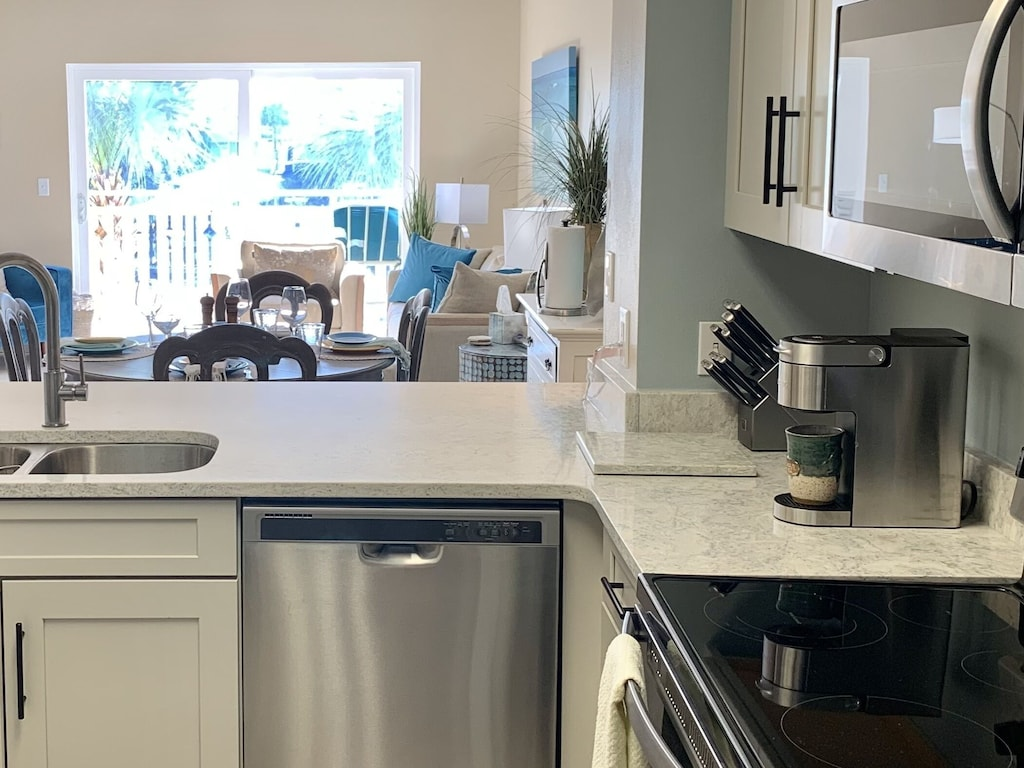 Completely renovated kitchen. Our quartz countertops literally sparkle!