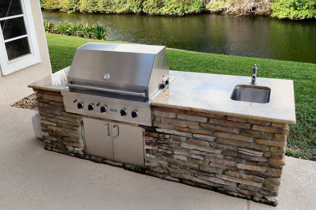Big Viking BBQ grill with outdoor sink and faucet