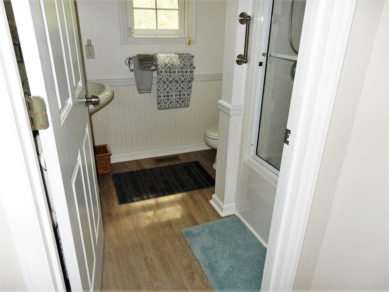 At the end of the hall is a full bath.