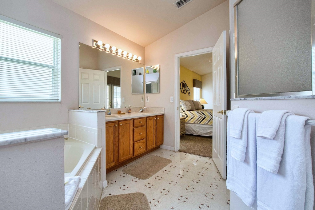 Opposite the huge, garden tub and sinks, is the large, walk-in shower stall.