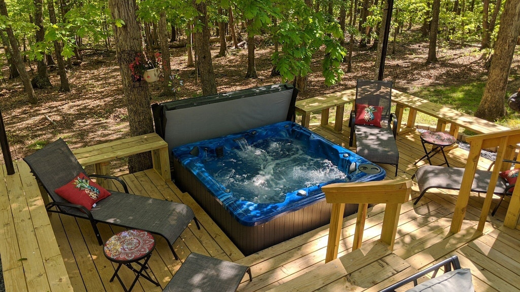 Huge beautiful back yard decks, hot tub, tables and lounge chair - nature all around!