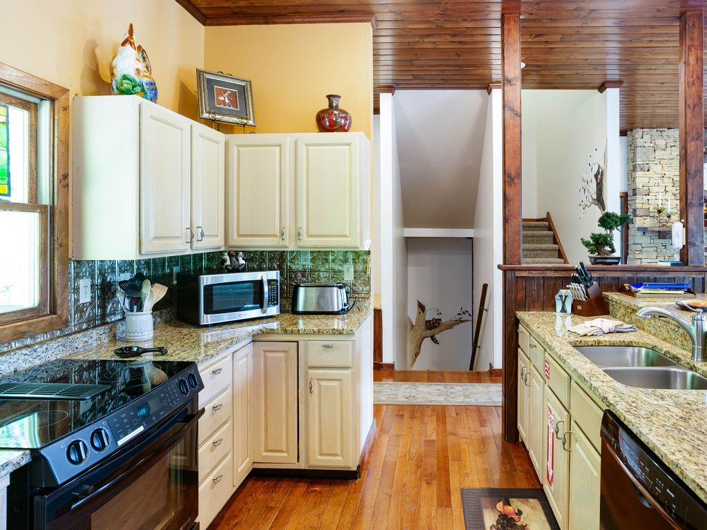 Social kitchen layout with granite counter tops.
