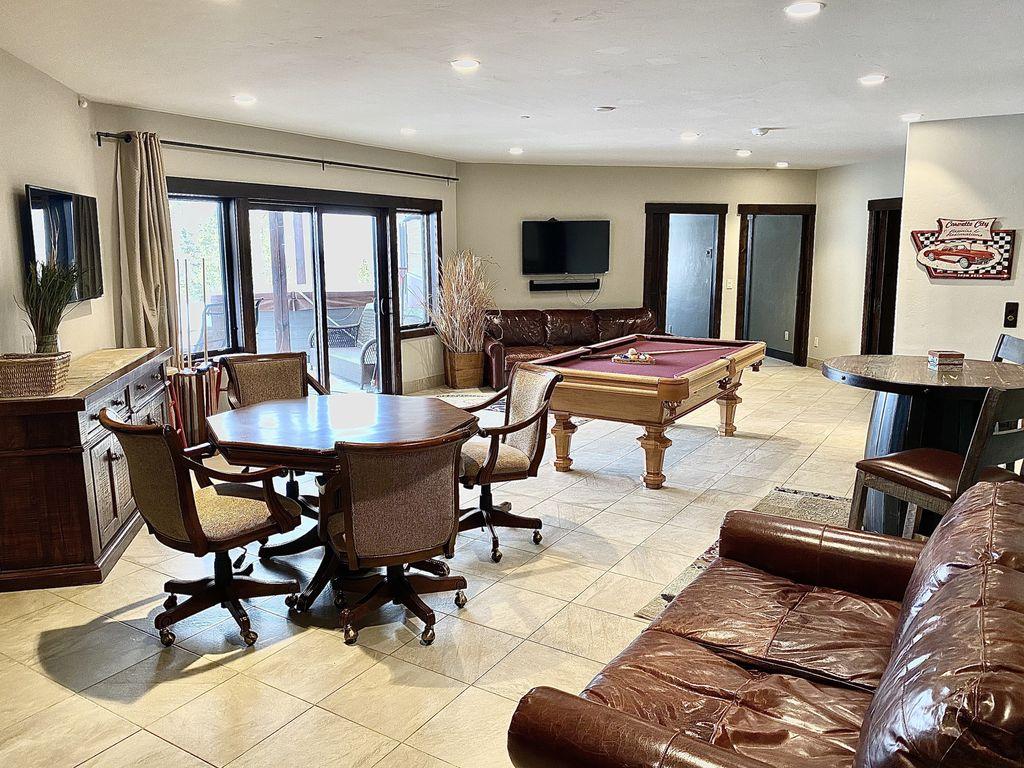 Game Room - Pool table, foosball table, poker table, multiple TVs