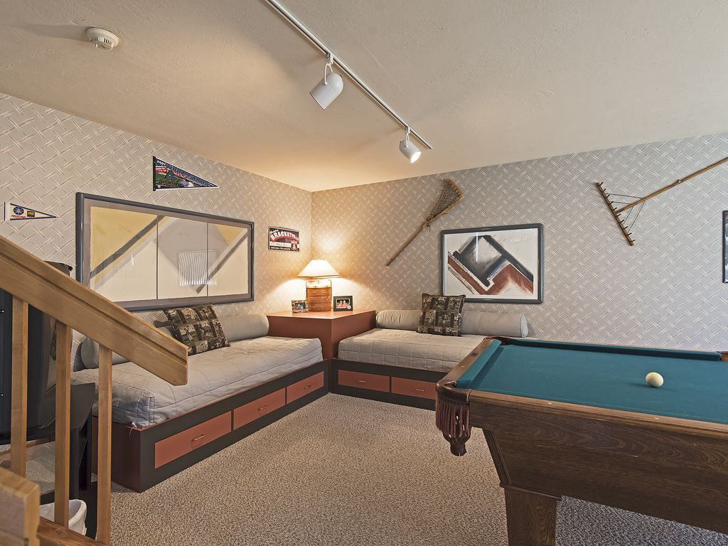 Two trundle beds on lower level family room.