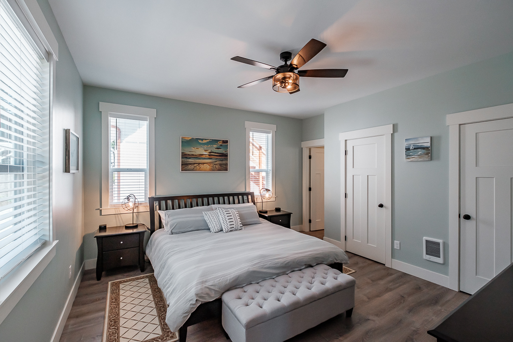 Main-floor bedroom offers spacious King, with en-suite bathroom.