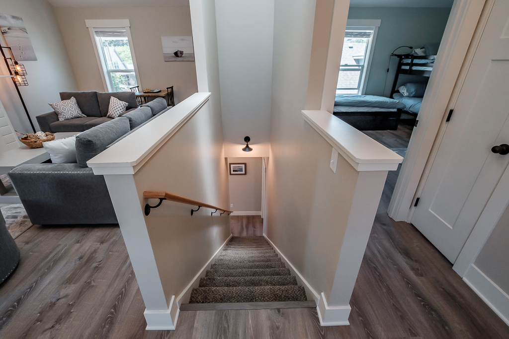Stairs with rail to second floor landing.