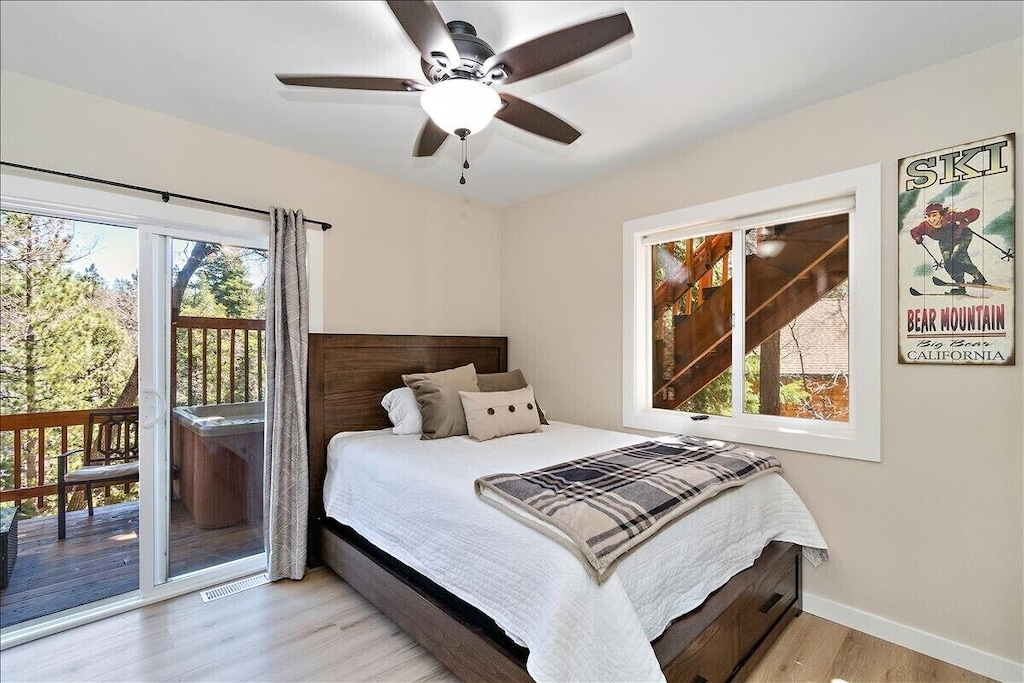 Downstairs bedroom w/ Queen bed with private access to Hot tub