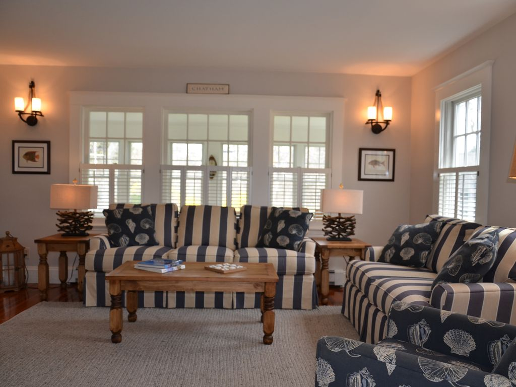 Living room overlooks enclosed front porch.