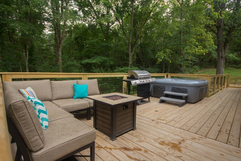 Spacious sitting area on deck with beautiful gas fire
