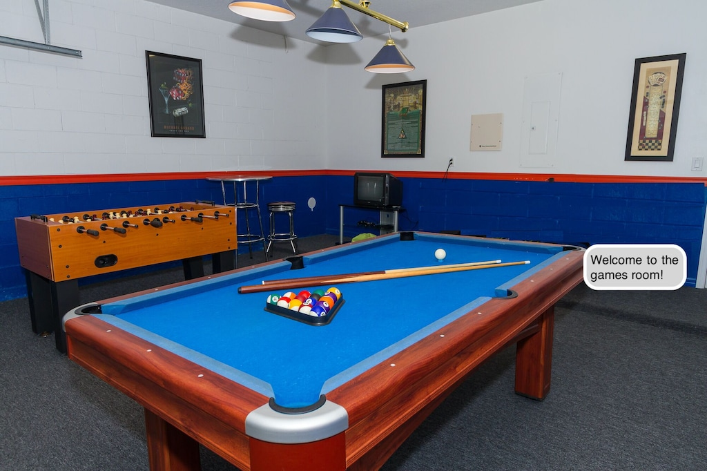 Game room in the garage with pool table and ping pong table ( no foosball table)