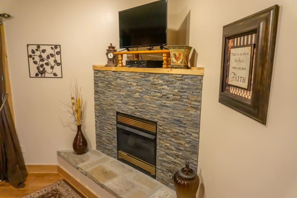 Main level king master suite fireplace