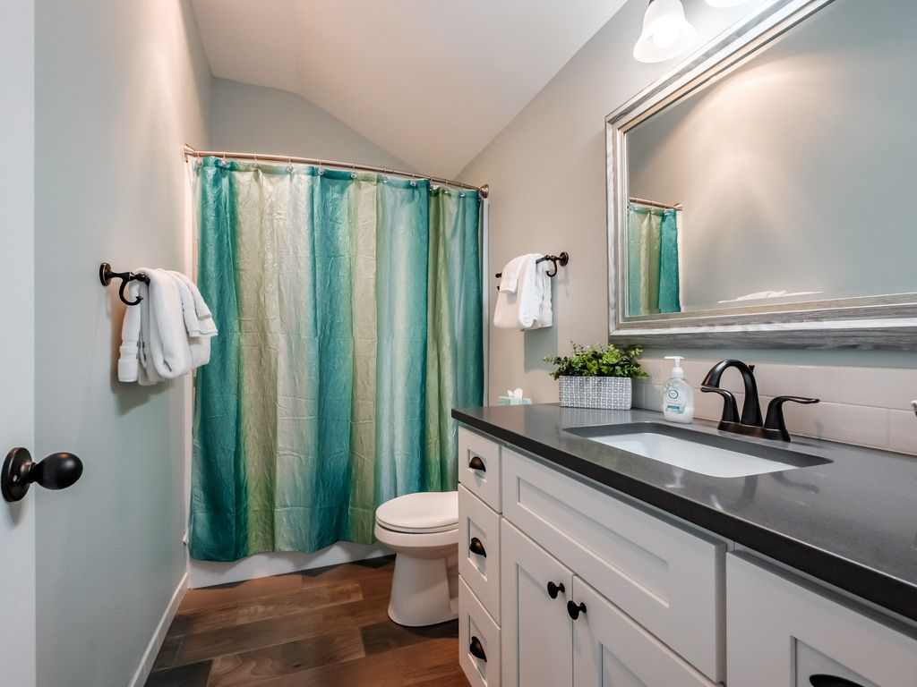 Upper level main bathroom is shared with back bedroom and bunk room.