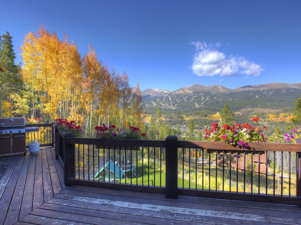 Typical autumn afternoon! - View from the deck.  Bbq to the left.  Flowers everywhere all summer long.