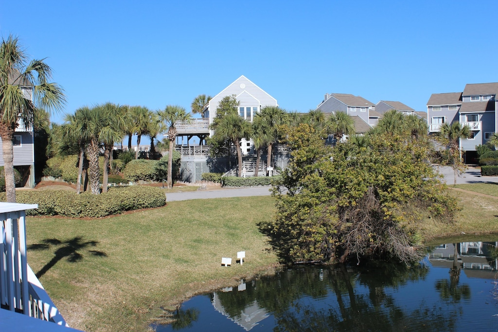 View of  gulf front clubhouse from deck at Dolphin's Dance