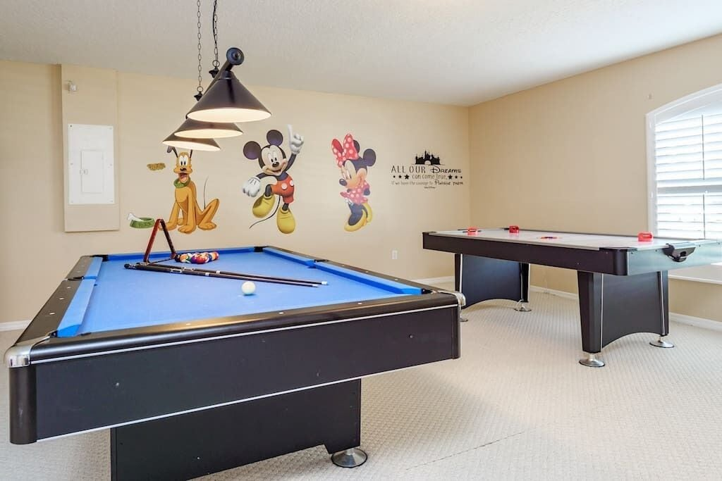 Themed Game Room with Pool Table and Air Hockey