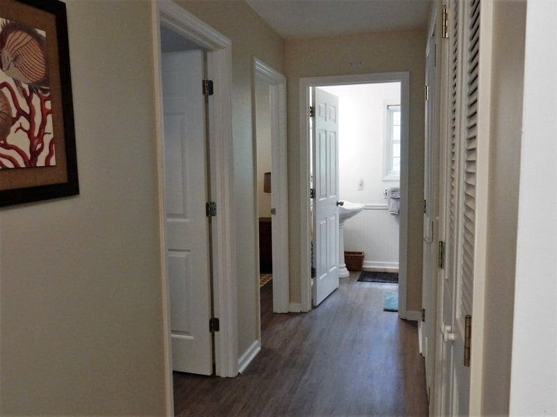 In the hall to the bedrooms is a closet that houses the laundry facilities.