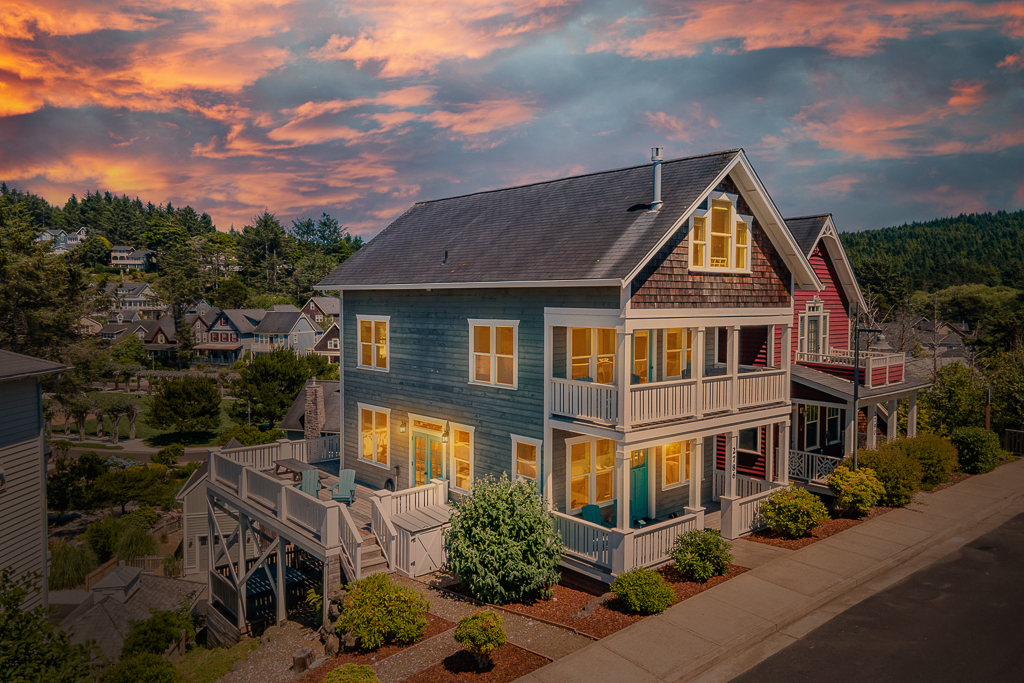 Rare four level Olivia Beach home, steps from beach access stairs and park.