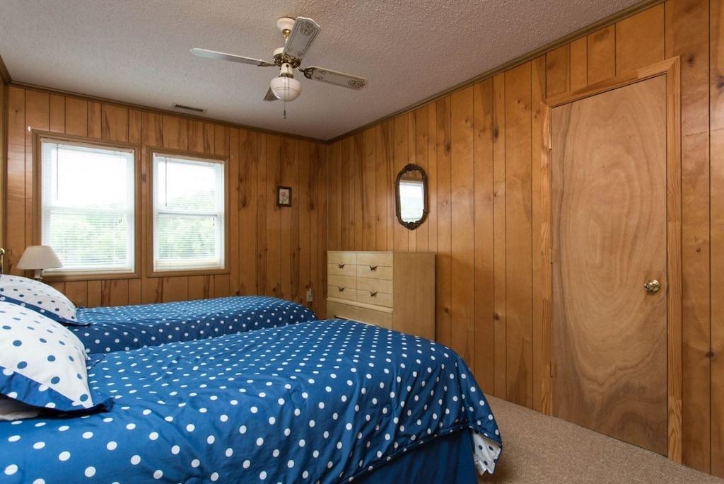 The third bedroom has 2 twin beds.