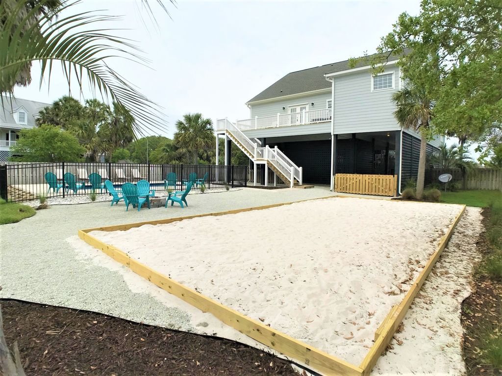 Overlooking sand pit for volleyball, fire pit and pool!