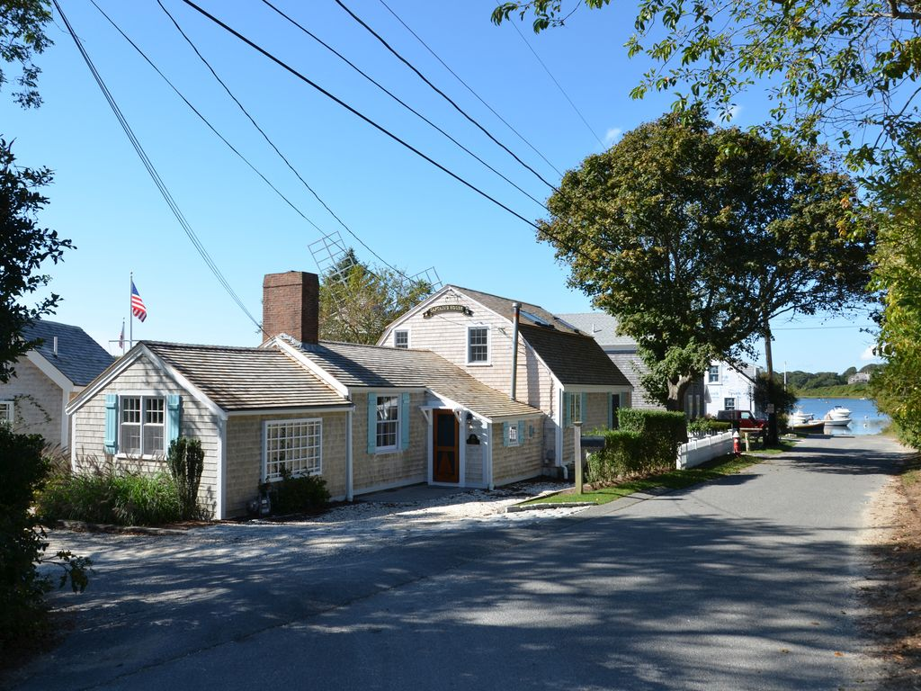 Classic  gambrel roof with cedar shakes exudes the original charm of this house.