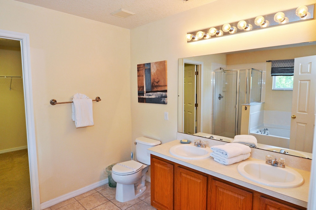 master bathroom with Jacuzzi and walking in shower.