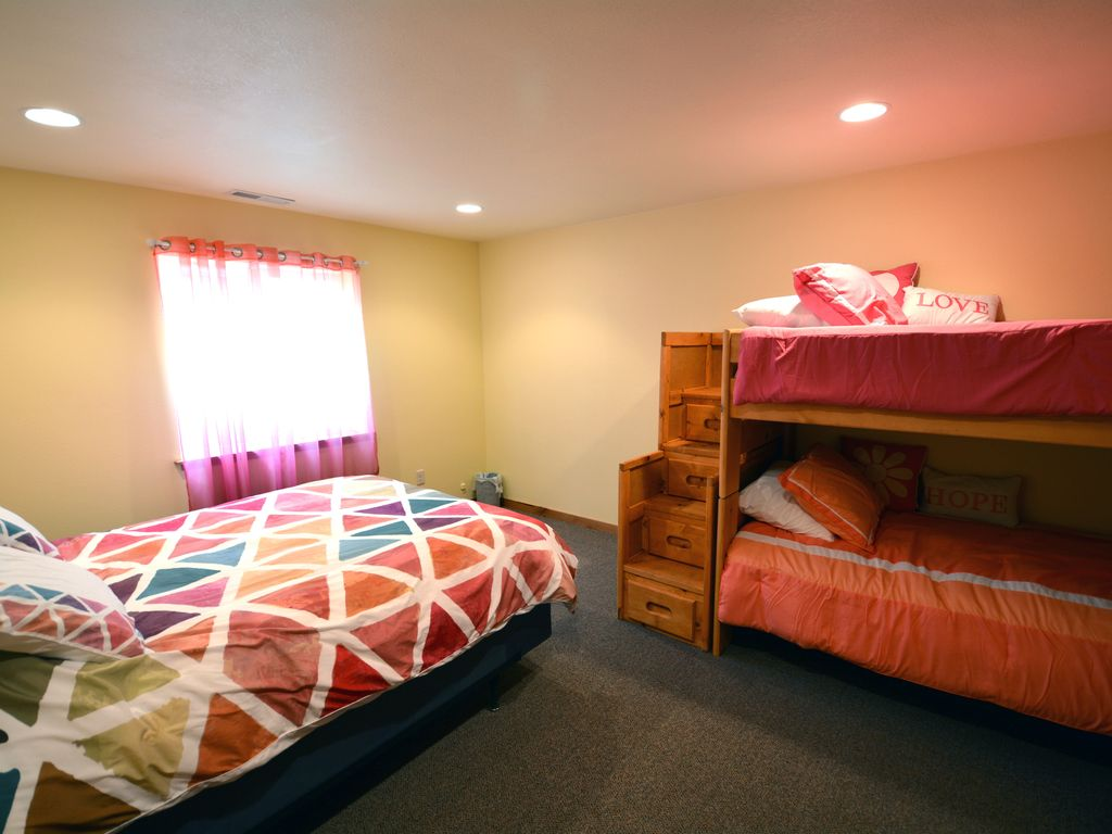 Downstairs bedroom. Queen size bed and bunk beds.