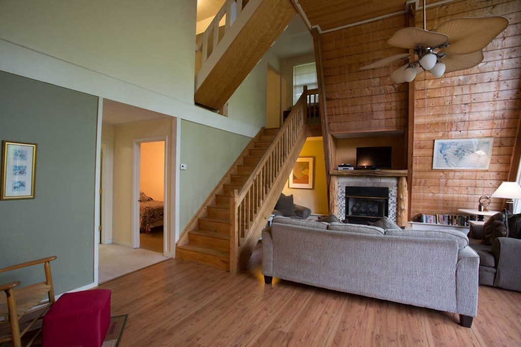 In the living area is comfortable furniture, a TV, and a gas log fireplace.