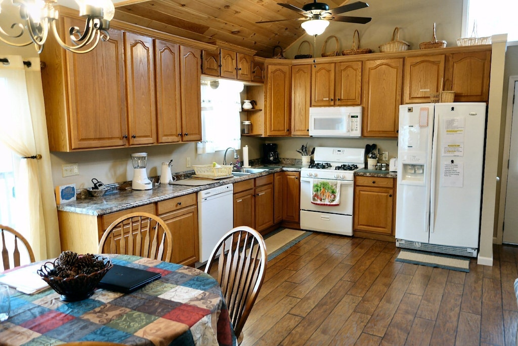 Full kitchen with wide open floor plan between kitchen, dining and living room