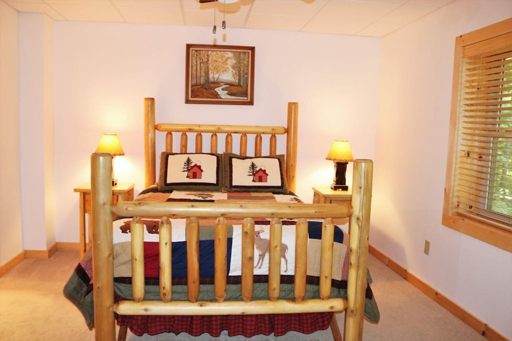 Lower level bedroom with queen bed and private bath