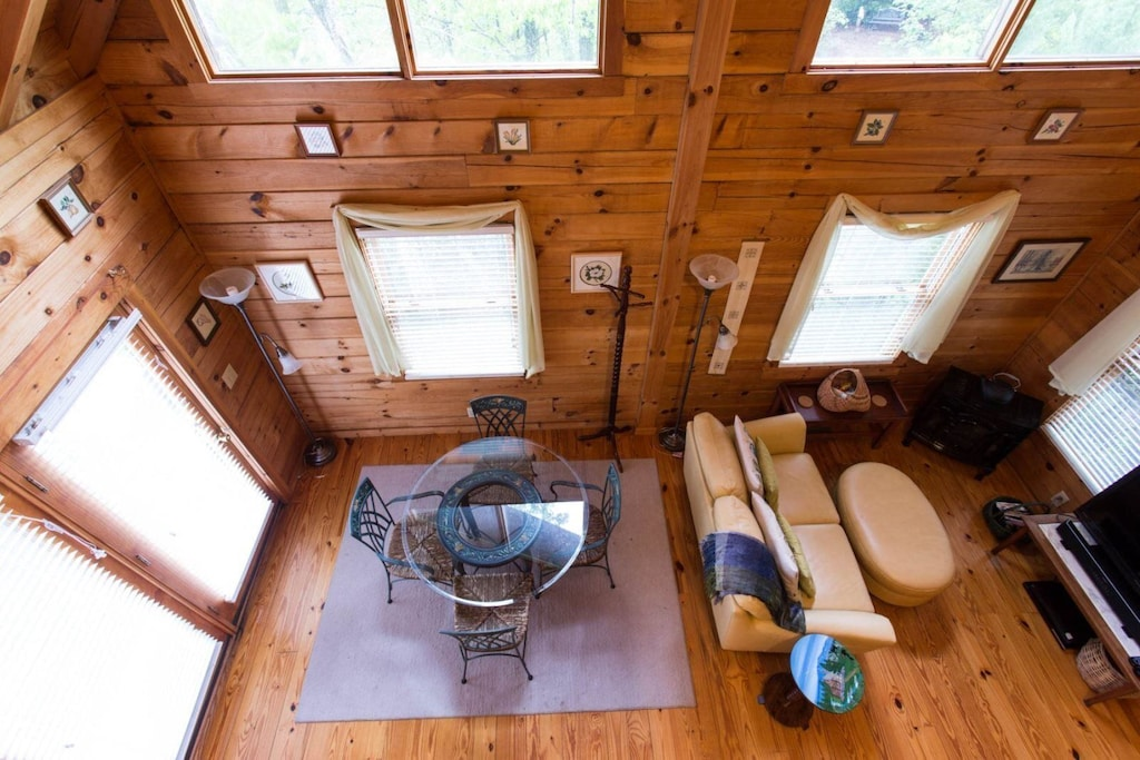 From the loft, you can see the living and dining areas.