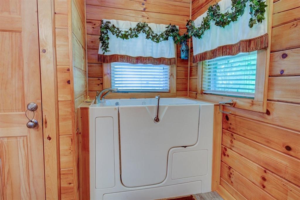 Main level master bath with walk in tub