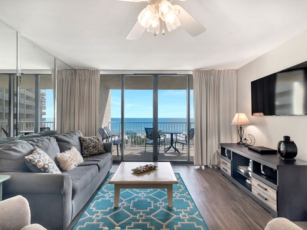 Living Room with Balcony Access and Beach View