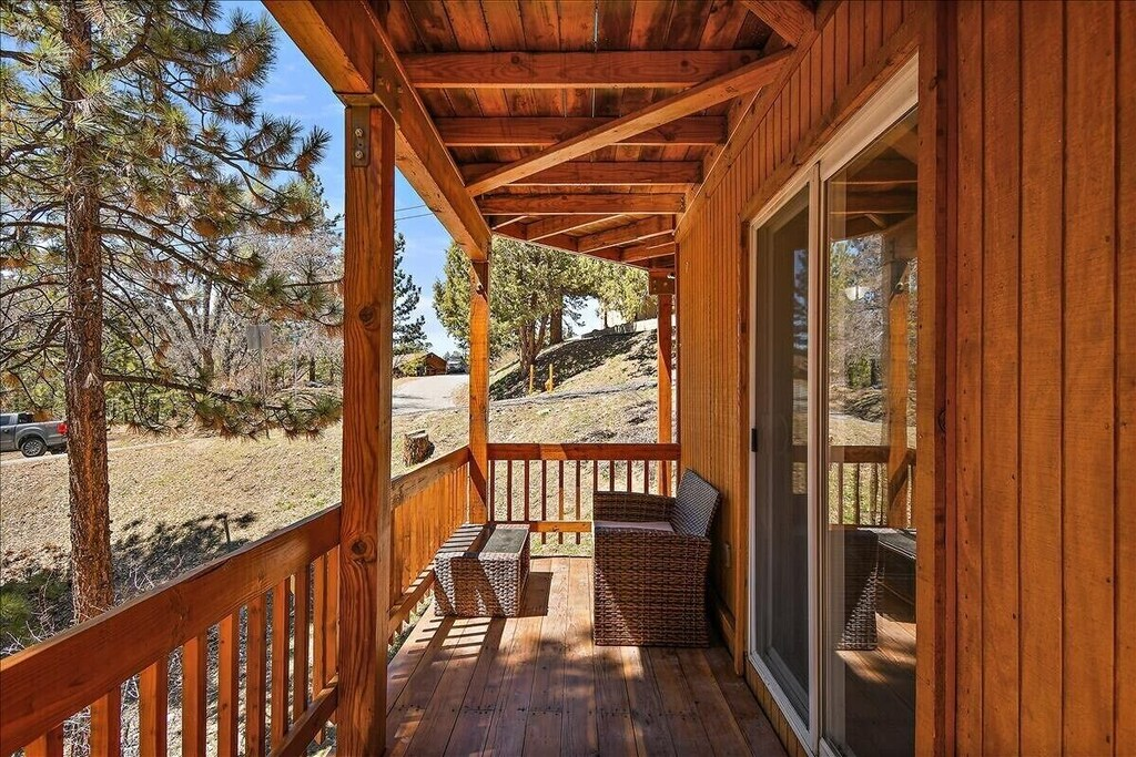 Private master suite balcony with views of ski slopes.