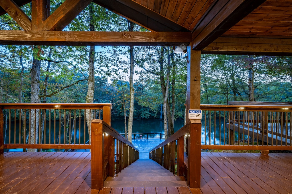 View from the  patio with stairs to the lower river level deck.