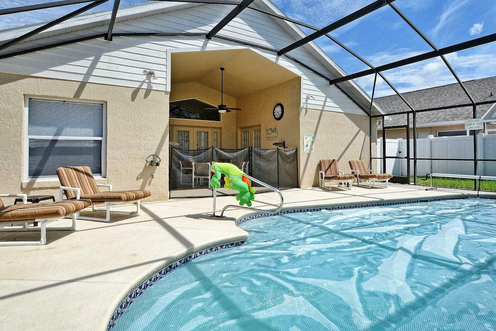 The pool with solar cover on and toddler fence up.