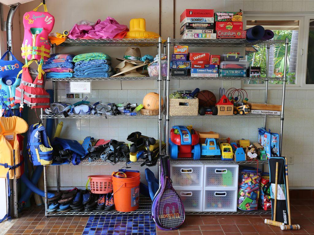 Board games, tennis rackets, croquet, snorkel gear, kids toys, life jackets.