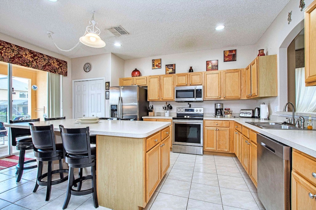 The kitchen has all stainless steel appliances.