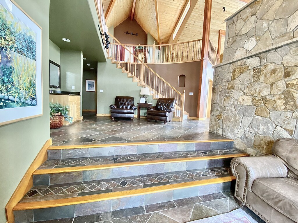 Entry way - Expansive entry opens up to great room. Wet bar on the left side. Loft is in the back ground