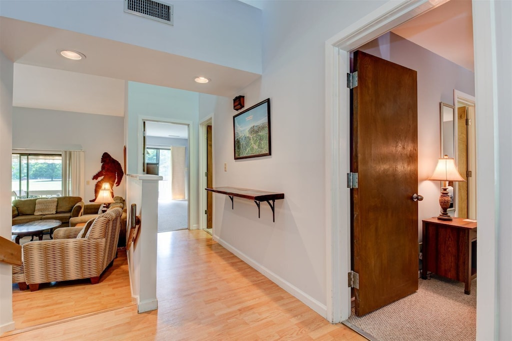 Hardwood floors and artwork throughout the unit