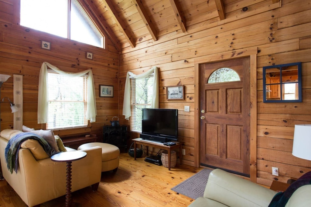 You enter in the living area complete with comfortable furniture, TV, and small gas stove.