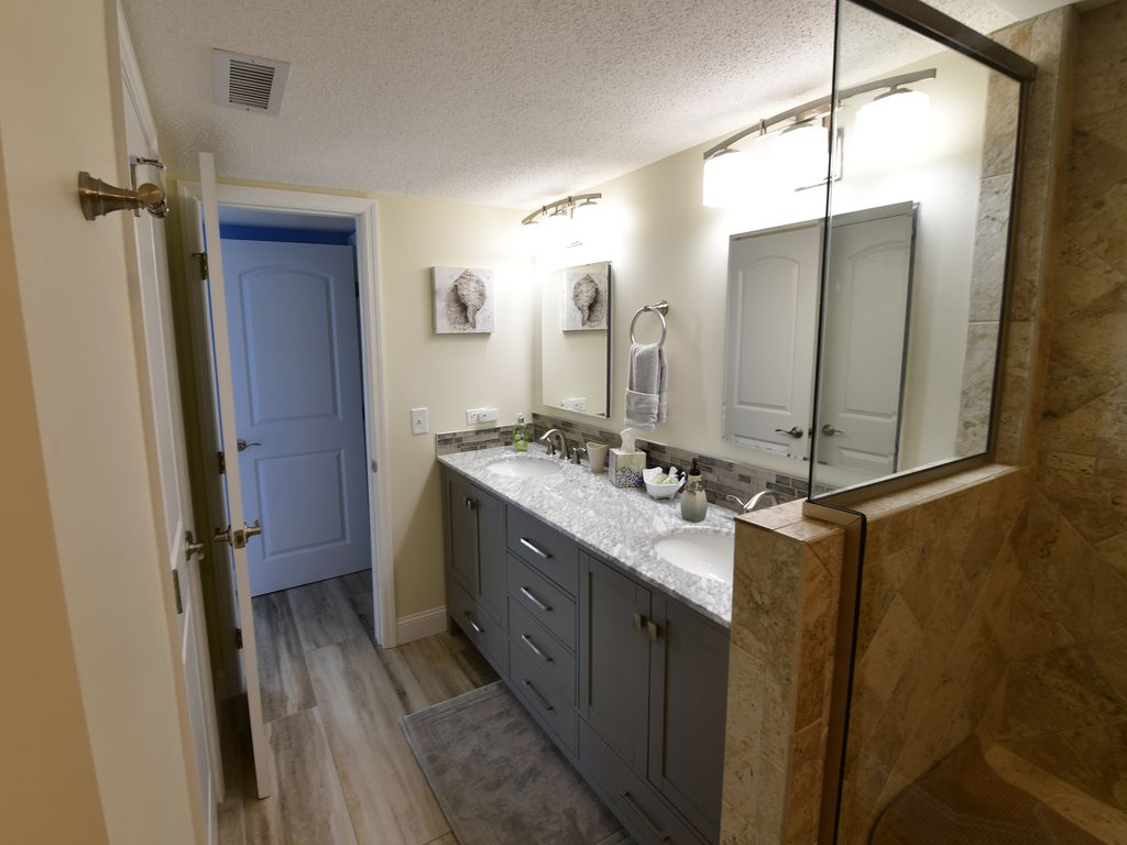 Newly Remodeled Master Bathroom w/ stand up shower & double sinks.