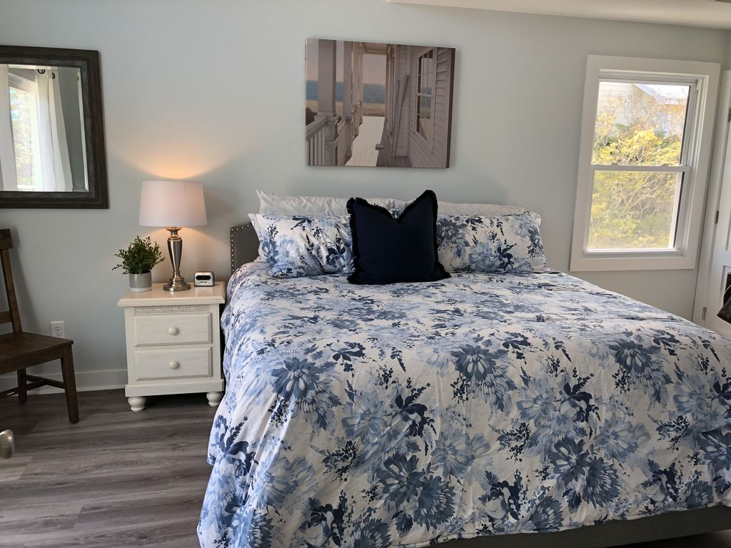 Updaters Master bedroom with king bed and full bath