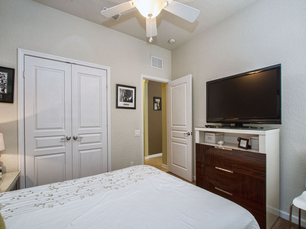 Downstairs bedroom with a smart tv for streaming episodes of your favorite show.