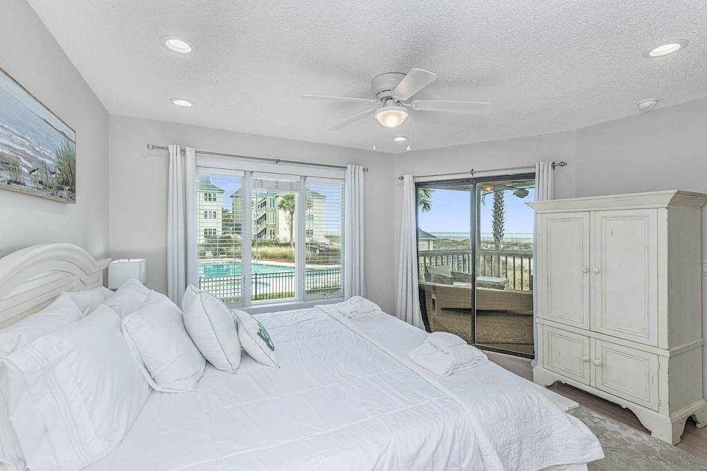 Wake up to beach & pool views from the master bedroom