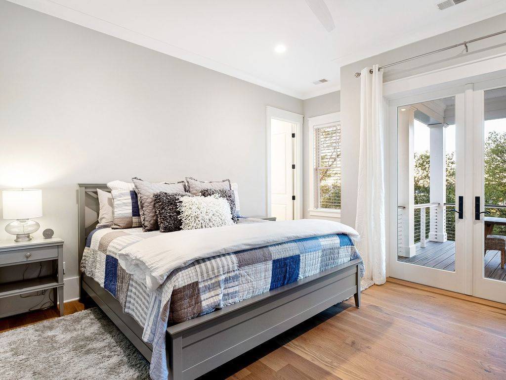 Junior master suite with access to deck overlooking the pool and intracoastal