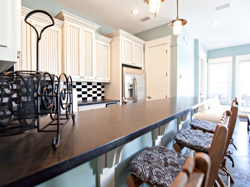in law suite kitchen, there is a queen sleeper sofa and a queen Murphy bed here