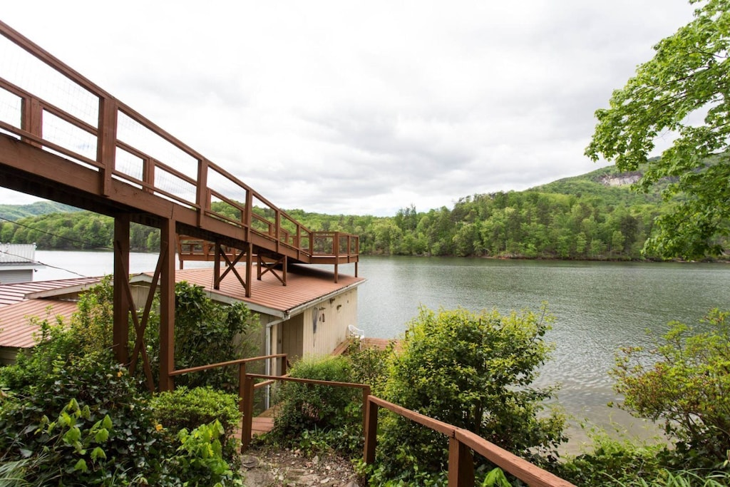 The ramp leads you back up to the lakeside deck of the home.