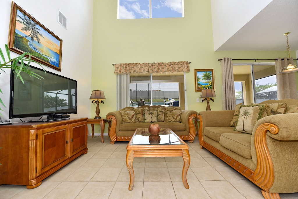 family room with large TV and new sofas