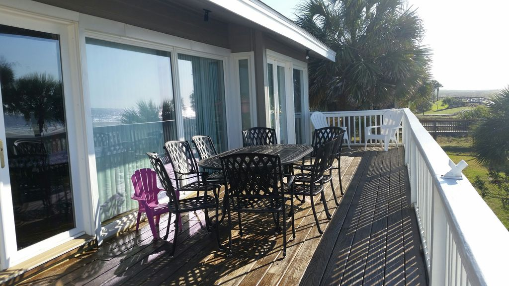 Large deck with dining table and sweeping Atlantic view