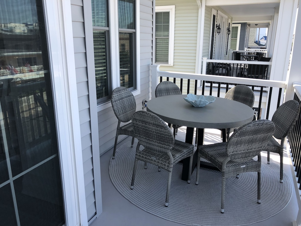 Front deck on second level provides a table and seating area